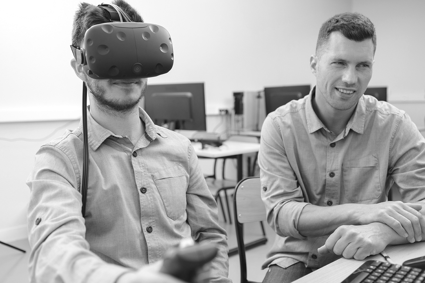 young man in technology lab using virtual reality headset